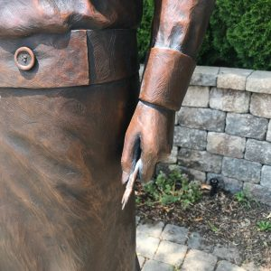 Close up of the hand and paintbrushes of the statue for the Radium Girls Memorial in Ottowa, IL