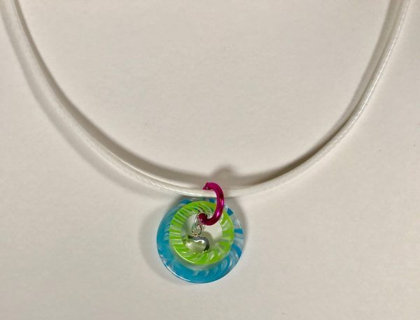 Colors of Summer Necklace by Being Bold; two resin rings plus a sterling silver heart on a white, braided, waxed cotton cord.