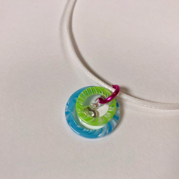 Colors of Summer Necklace by Being Bold, two resin rings plus sterling silver heart of a white, braided, waxed cotton cord.