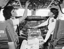 Beverly Burns and Lynne Rippelmeyer on the flight deck of a Boeing 737, September 1, 1982. In this small black and white image, two women pilots prepare for take off, as they check the various instruments in the jet.