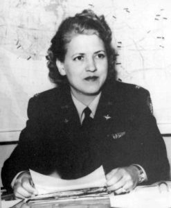 Jackie Cochran in 1943, while serving as director of the Women Airforce Service Pilots. She is in military uniform, with a map on the wall behind her.