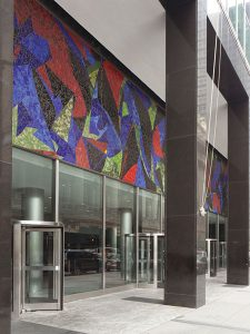 Image of a building with a mosaic above the entrance. Colorful, abstract mosaic was made in 1959 by artist Lee Krasner.