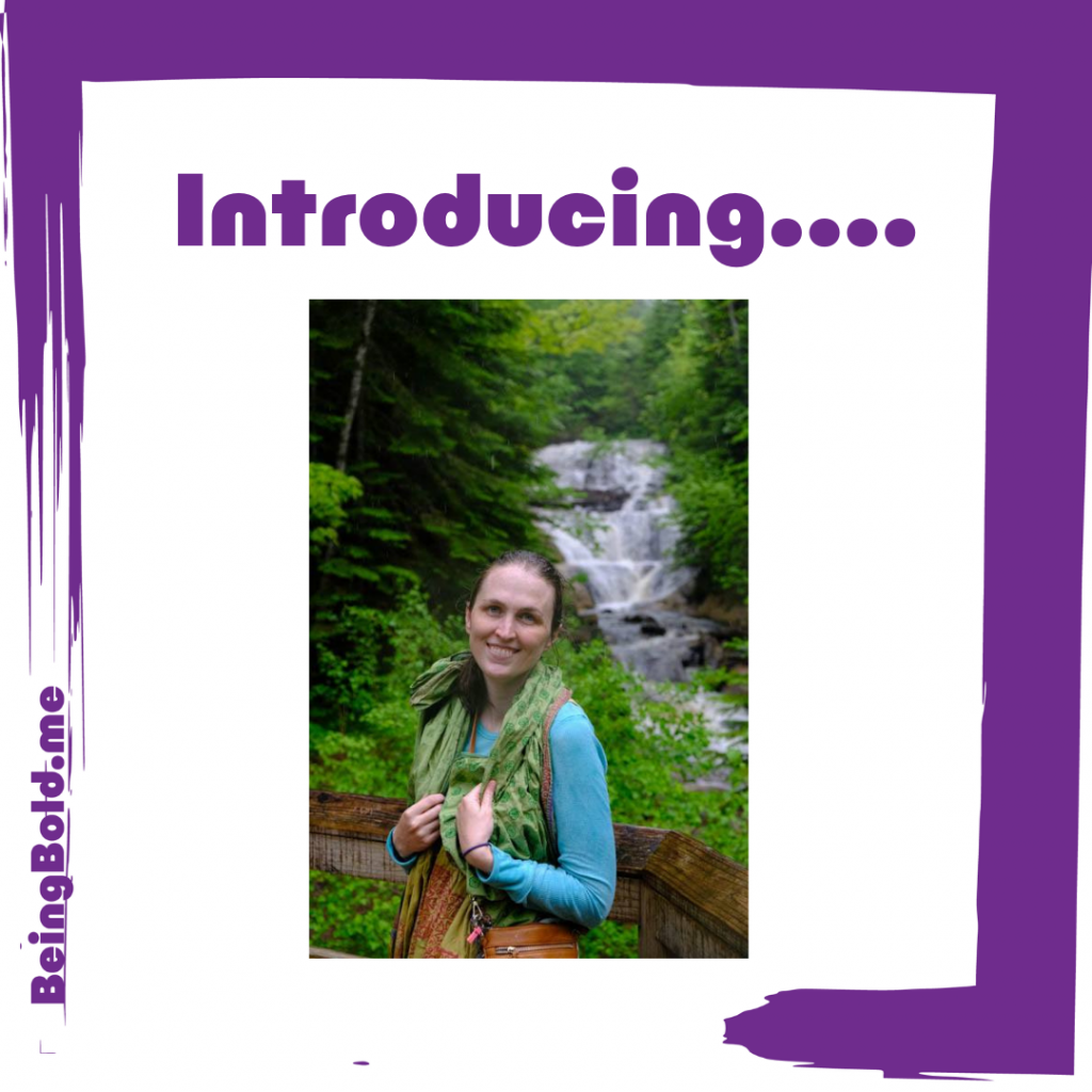Artist Betsy Zacsek, standing in front of a waterfall.
