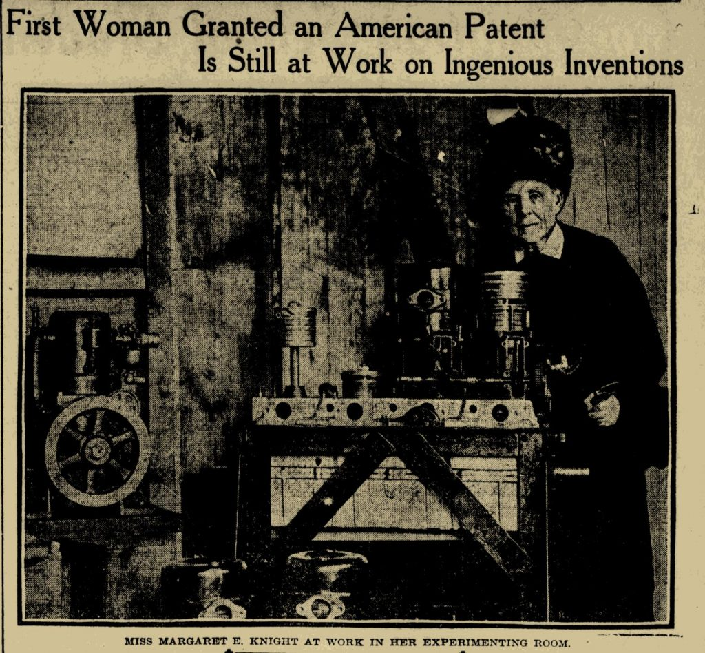 Margaret E. Knight in the Boston Sunday Post March, 31 1912 p. 45. A grainy black and white picture on yellowed newsprint shows an older woman standing next to a work table.